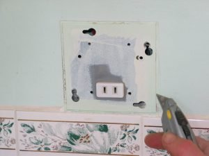 Carefully Cut the Joint Between the Mounting Plate and the Wall